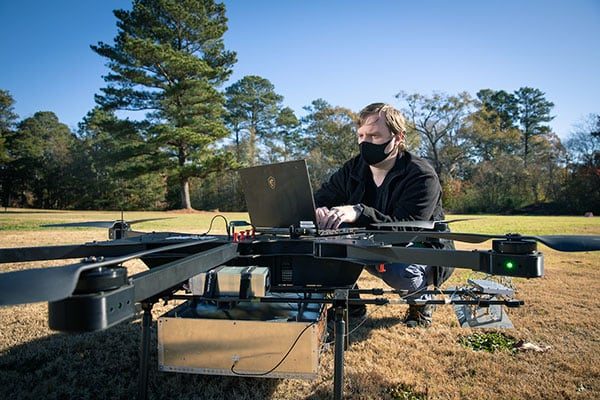 Christopher Simpson works with a drone prototype