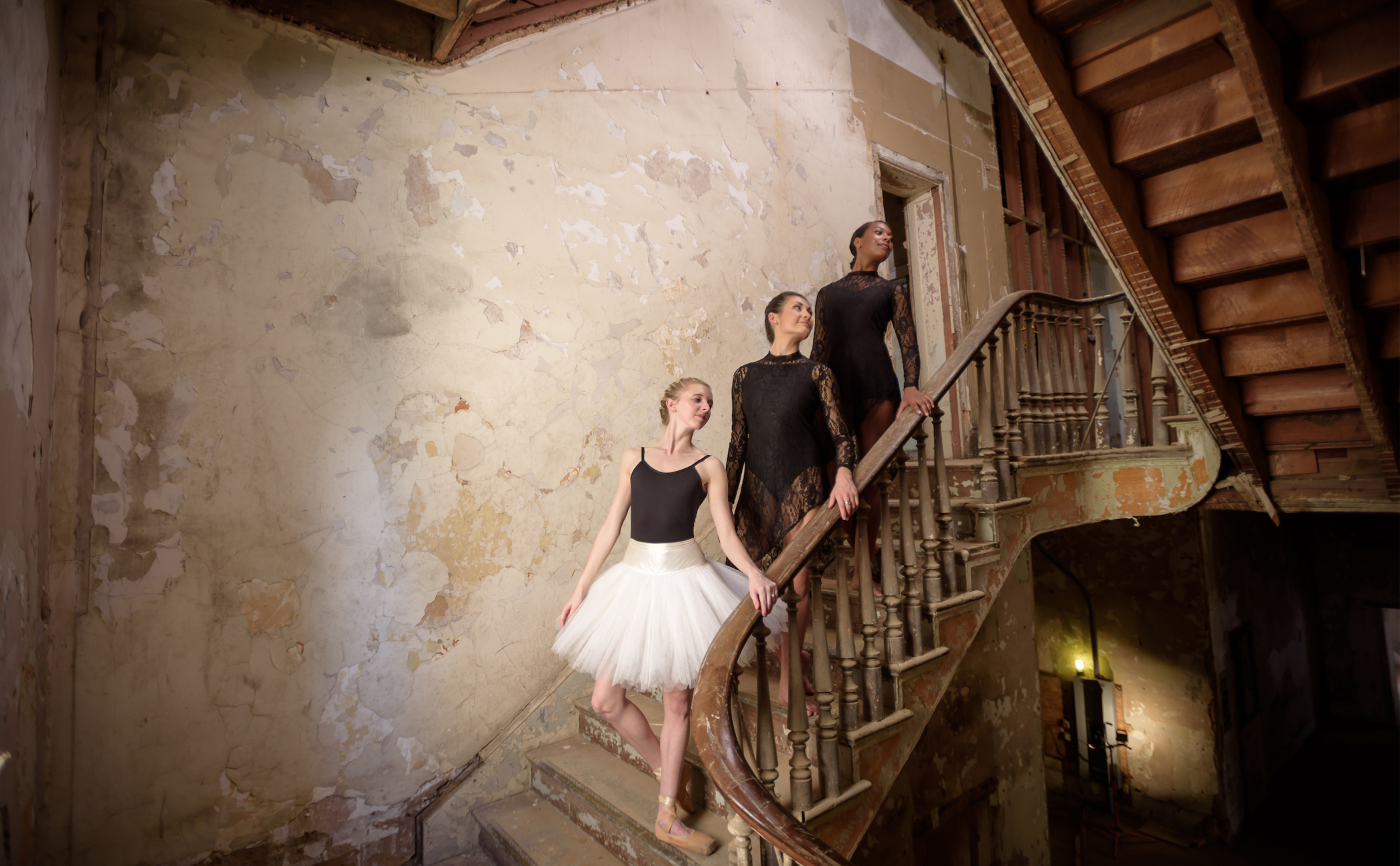 Ballerinas pose on the stairs of the future Performing Arts Center