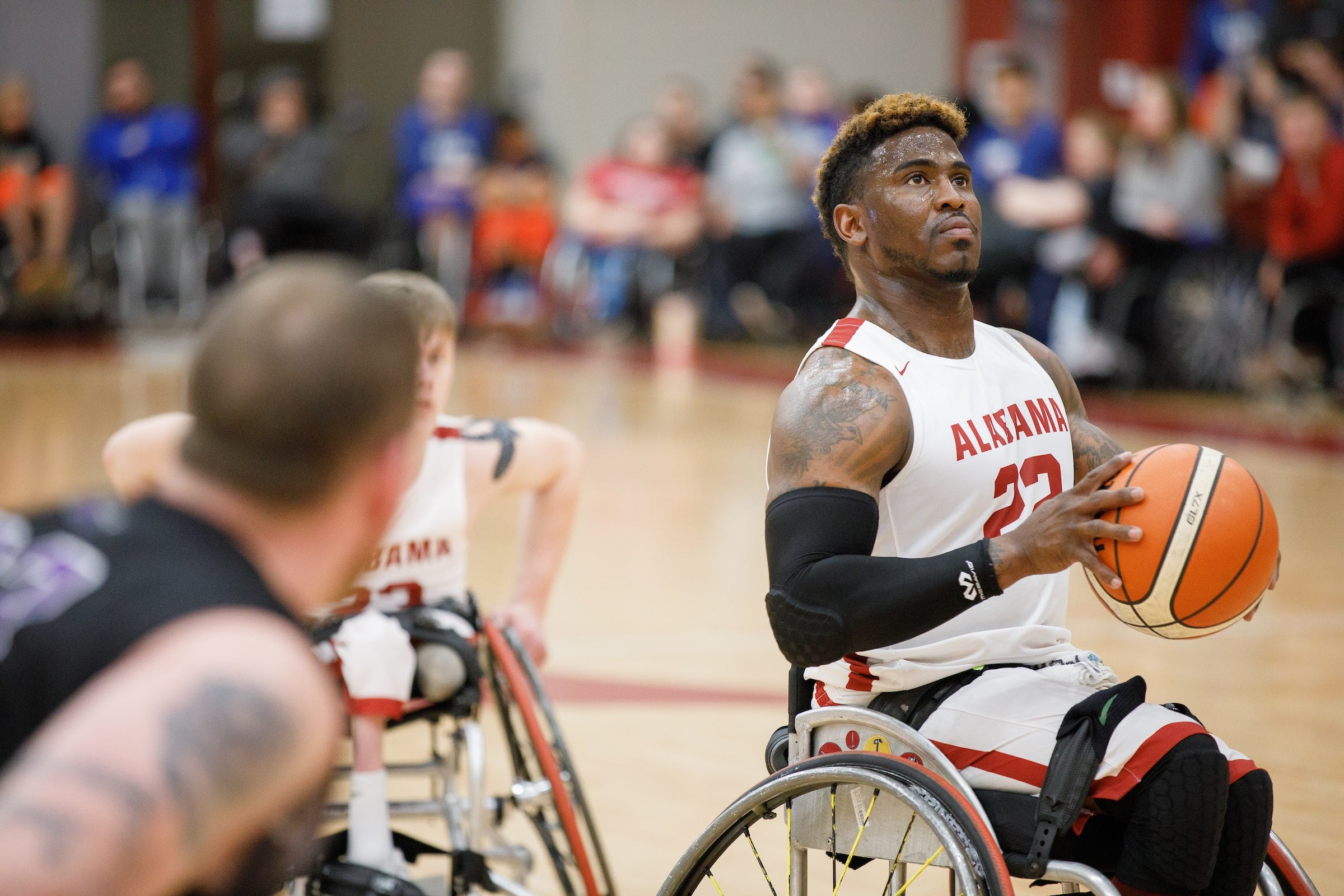 A wheelchair basketball player lines up for a free throw