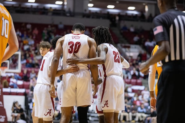 The basketball team huddles together during a game