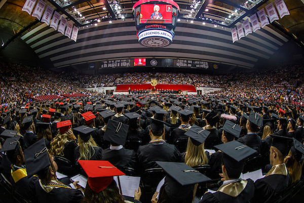 Hundreds of students watch the commencement ceremony in Coleman Coliseum