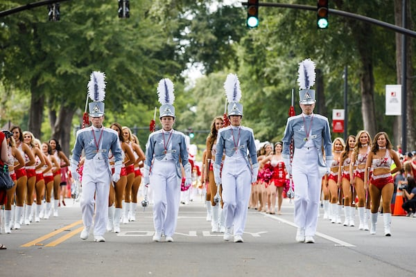 The drum majors lead the million dollar band during the homecoming parade