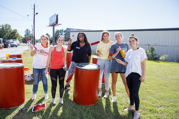 Honors students participate in a service project to paint a local business.