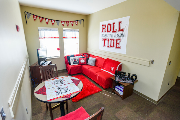 A student's living room decorated with UA banners.