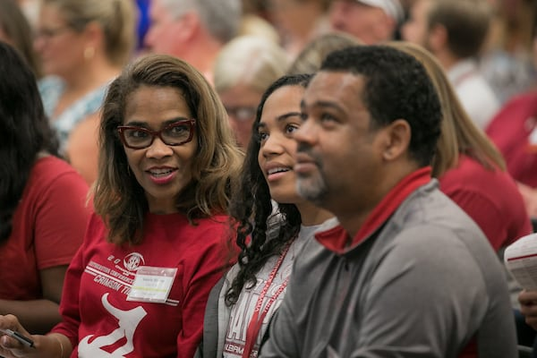 A student and her parents participate in the first orientation session.