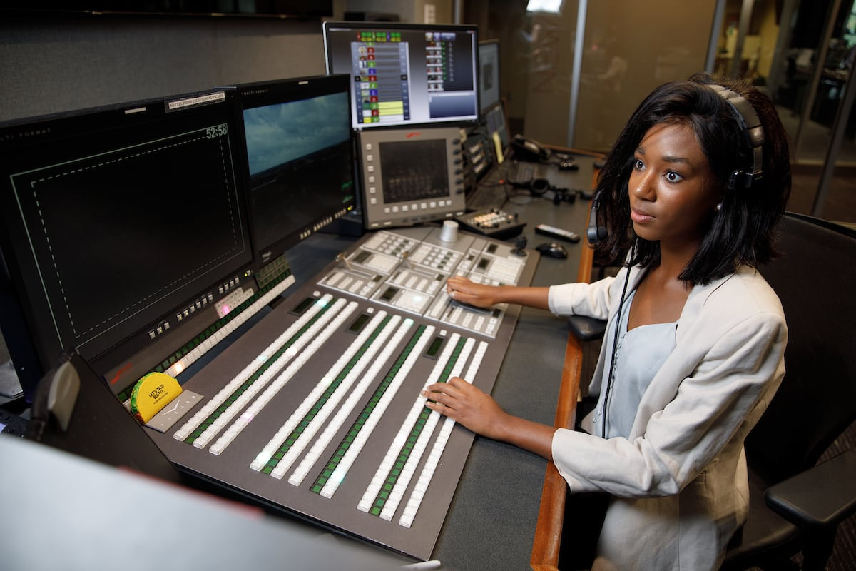 A student works with equipment in the digital media center