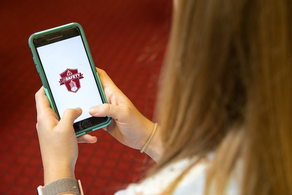 A student loads up the UA Safety app.