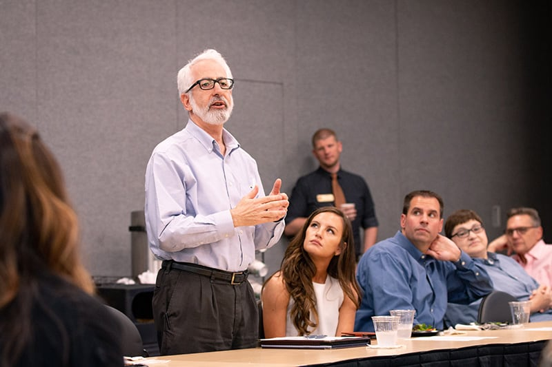 A faculty member presents at a CCBP meeting