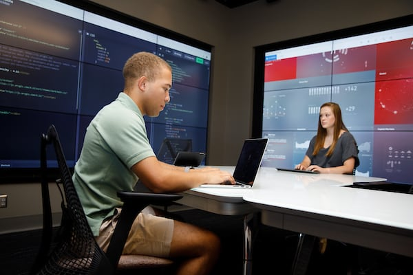 Two students work together in the Hewson Analytics Lab