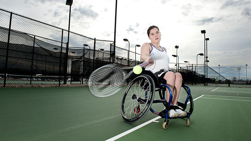 A wheelchair tennis player competing
