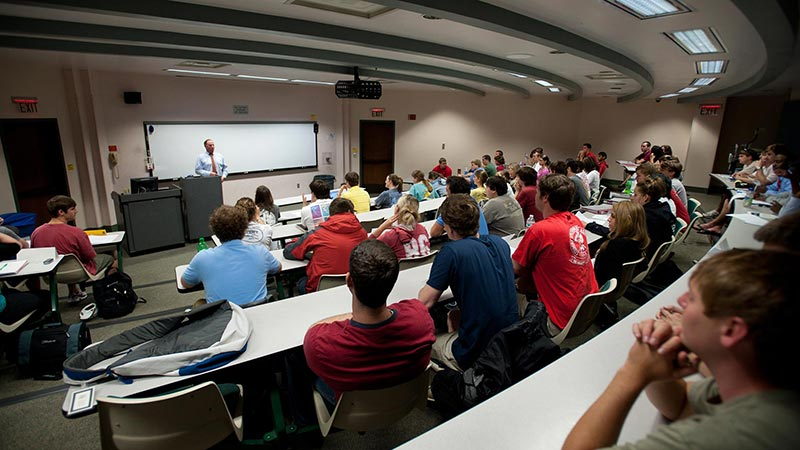 A professor gives a lecture in a classroom
