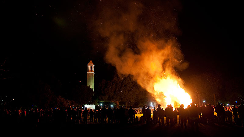 A homecoming bon fire with Denny Chimes in the background