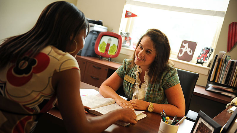 A staff member helps a student find housing