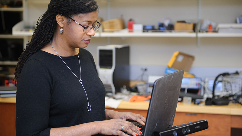 Faculty member on a computer
