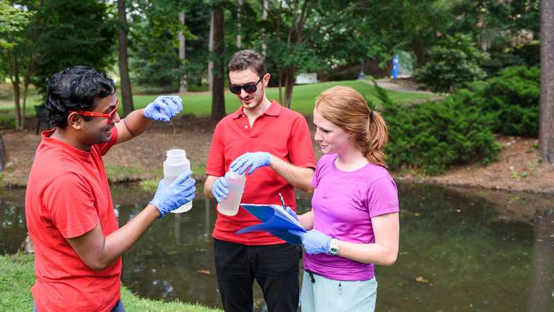 Graduate students analyze water samples from Marr's Spring.