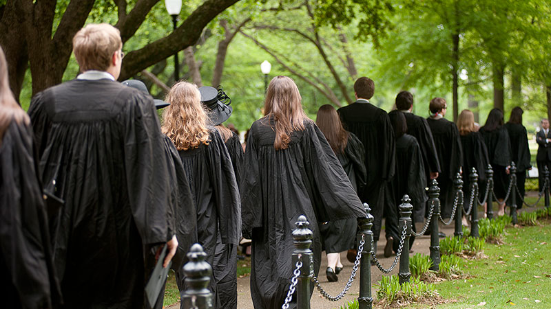Honors students walking across campus on Honors Day