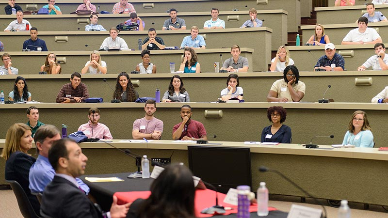 Law students have a discussion before class