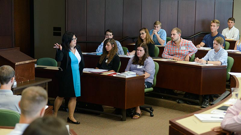 Students listen to a lecture in a Law classroom