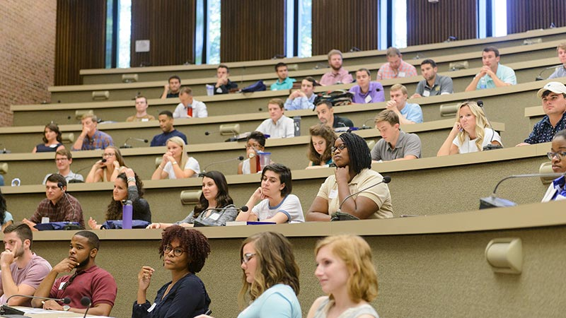 Law students listen to a lecture