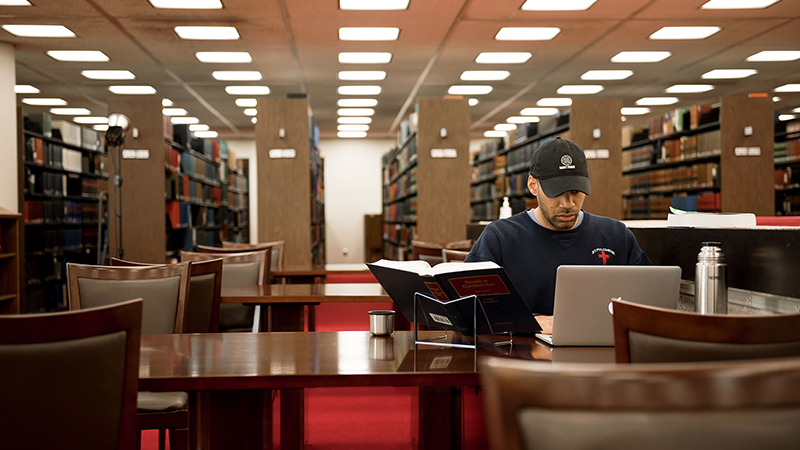 Law student studies in the law library