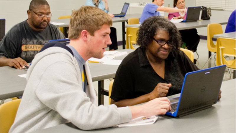 UA students teaching computer skills to the community.