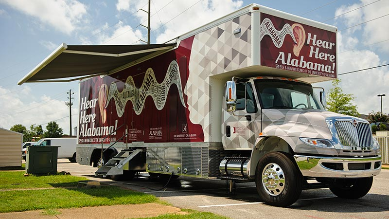 University of Alabama students take a hearing clinic on the road to rural Alabama counties.