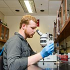 Samuel Stanley, a senior microbiology major, studies microbes in the Caldwell Lab in the Science and Engineering Complex at UA.