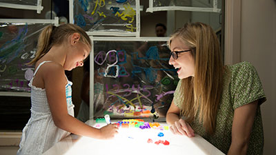 Student working with a young child
