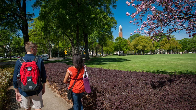 Two students walking on the Quad
