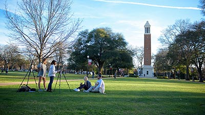 Students filming on the Quad