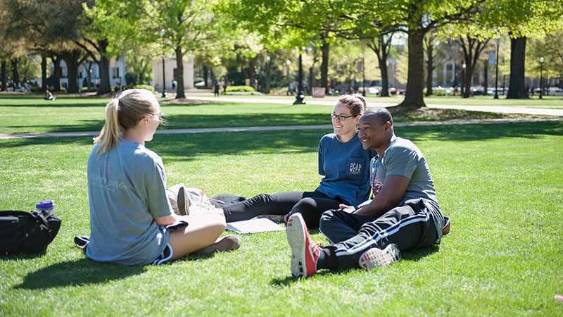 Students sitting on the Quad in spring