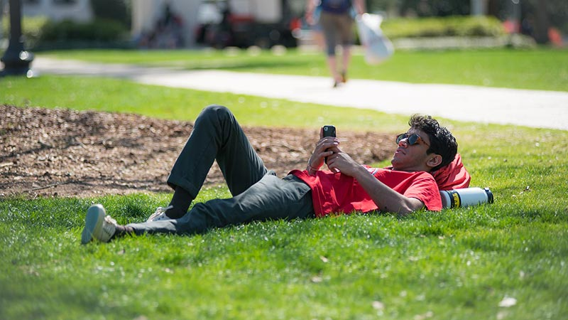 A student engages in social media on their phone