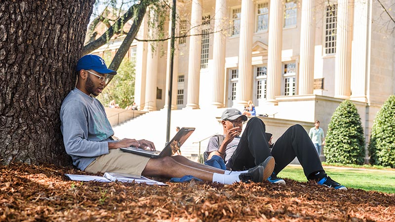 Students studying on UA's beautiful Quad