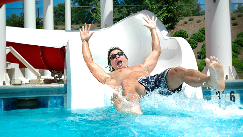A student takes a plunge down a waterslide at the Rec Center