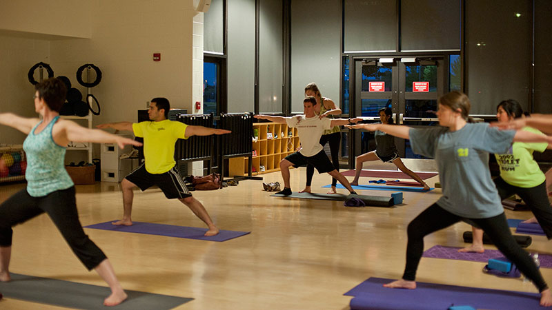 Students participating in a yoga class