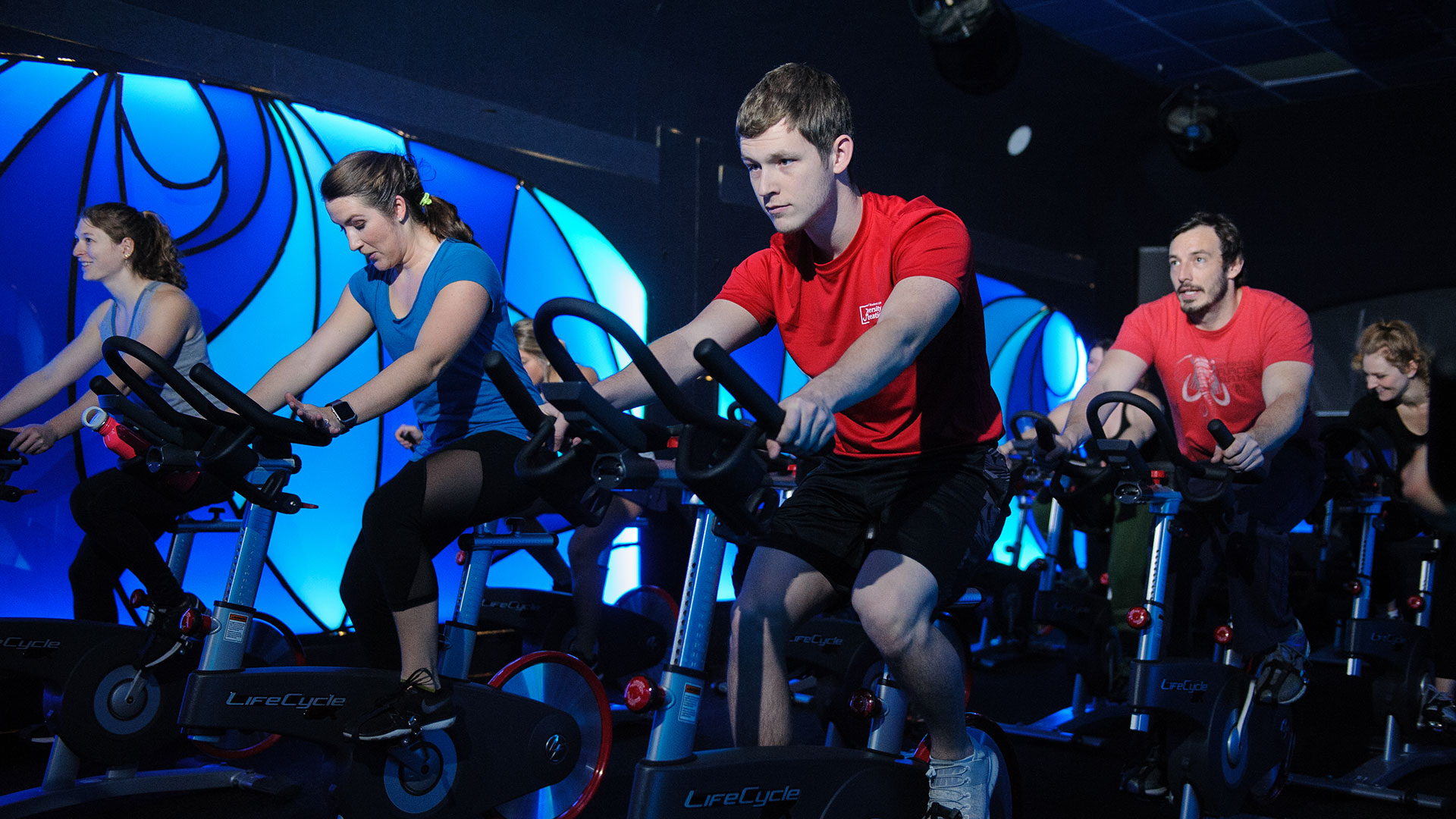 Group fitness cycling class.