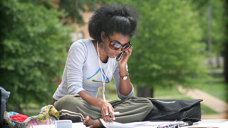 A student studies on the Quad