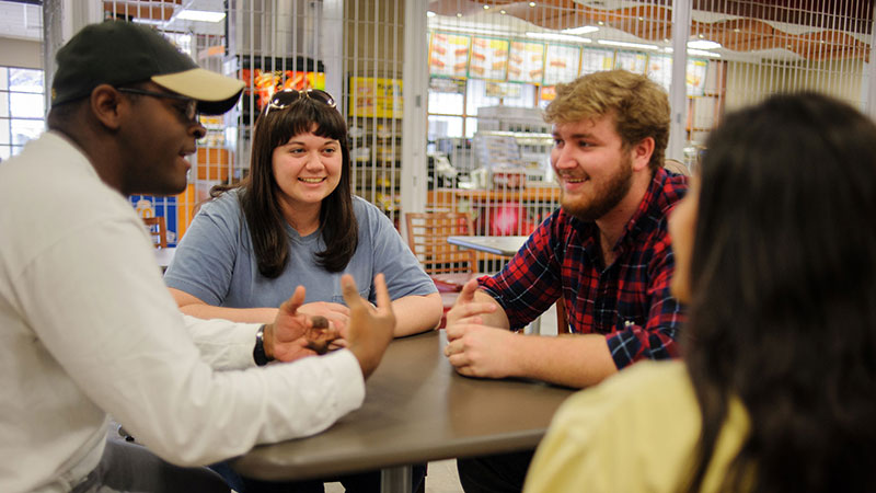 Students chatting in a dining facility