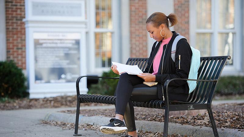 A student studies on the Quad