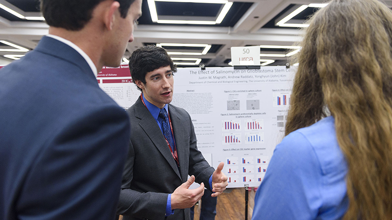 A student talks at the Undergraduate Research and Creative Activity Conference