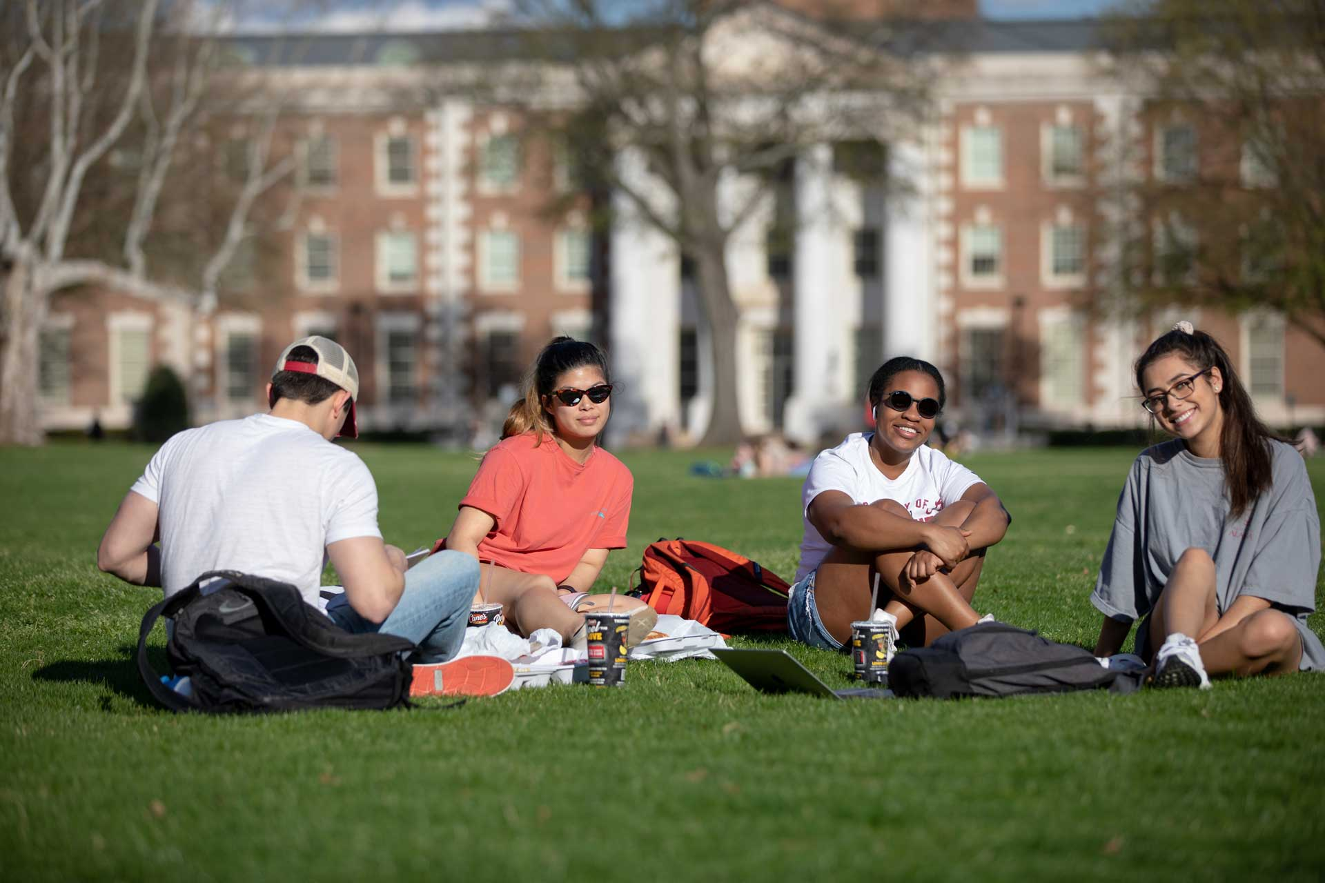 Group of students sitting on the quad.